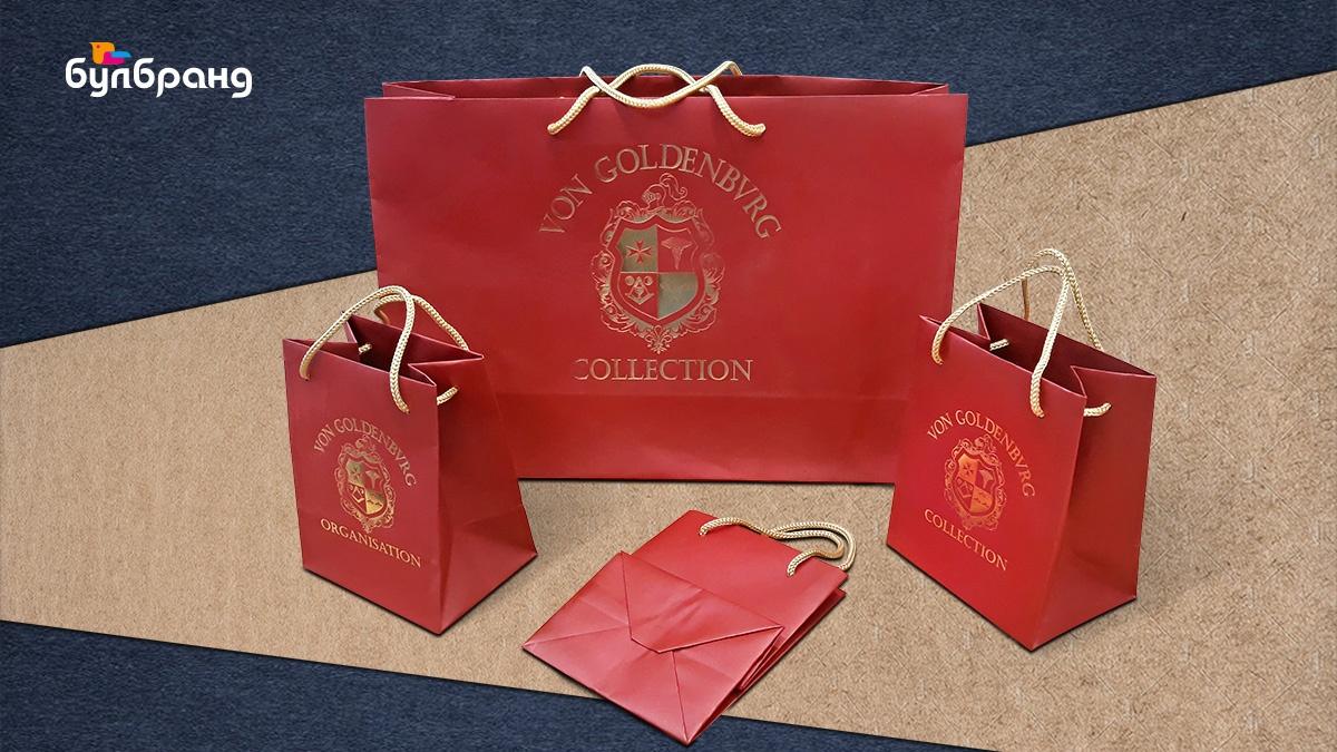 """Изработка на луксозни хартиени торбички, различни размери, от тониран картон бордо, текстилни дръжки, топъл печат """"Gold"""", бранд: von Goldenbvrg Collection бранш: мода, дрехи, Булбранд Медия ООД"""